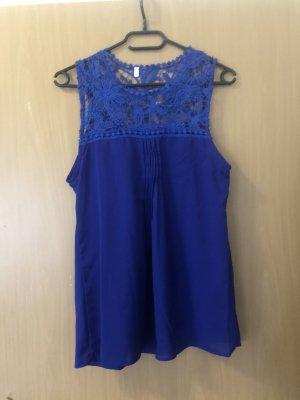 Top di merletto blu