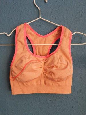 Crivit Reggiseno arancione chiaro-arancio neon
