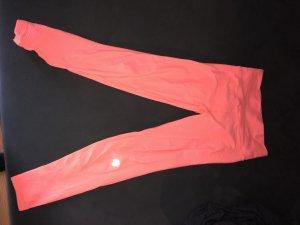 Pantalon de sport orange fluo
