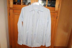 Sportlich feminine Hemdbluse von Prada; Größe 38