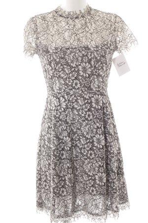 ST. Vestido de encaje blanco-negro elegante