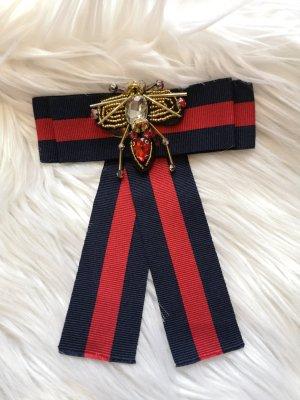 Brooch red-dark blue