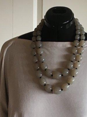 Joyería gris verdoso-negro