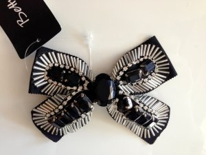 Betty Barclay Broche negro-color plata