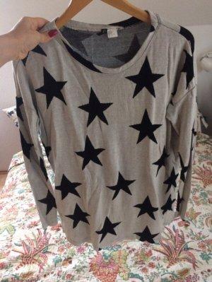 Sternenpullover grau-schwarz mit Schlitz