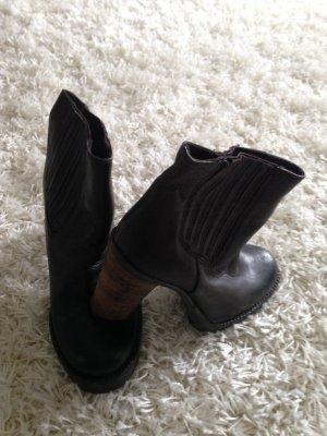 Botas deslizantes marrón oscuro Cuero