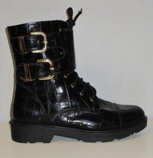 Stiefeletten Chelsea Boots flach schwarz mit goldenen Schnallen Lack Heine