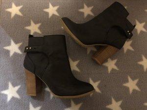 H&M Botas deslizantes negro-color oro