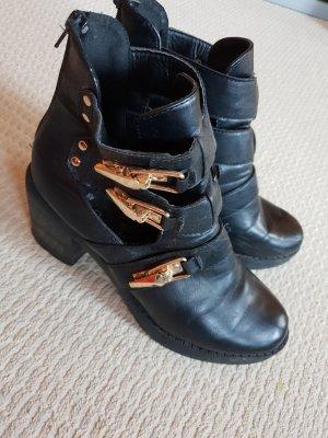 Stiefeletten/ hohe Schuhe/ Stiefeletten mit Schnallen