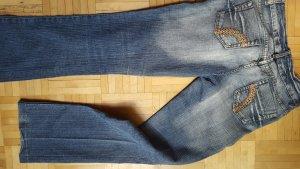 Jeans elasticizzati arancione-azzurro