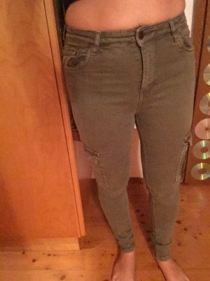 Stretch Jeans khaki grün Reißverschluss Applikationen Taschen seitlich