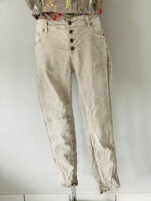 Jeans cigarette brun sable