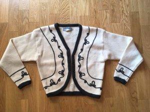 Boléro en tricot noir-blanc cassé