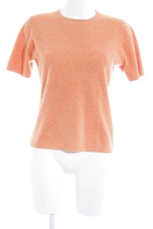 Camisa tejida naranja claro estilo minimalista