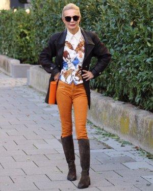 stylische Hose in Reptilprint orange