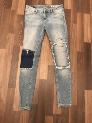 Stylische Review Jeans