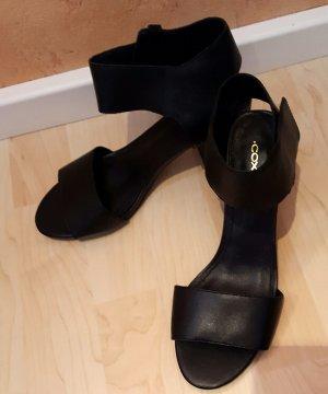 stylische schwarze Sandaletten