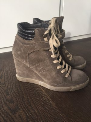 Stylish olive-green Buffalo sneaker wedges perfect for the fall/ spring outfit
