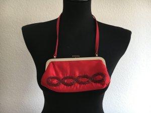 Süße kleine rote Tasche