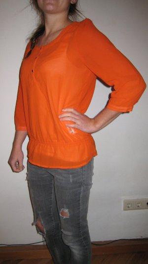 süße orangefarbene Bluse