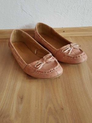 Süße rosa Ballerinas
