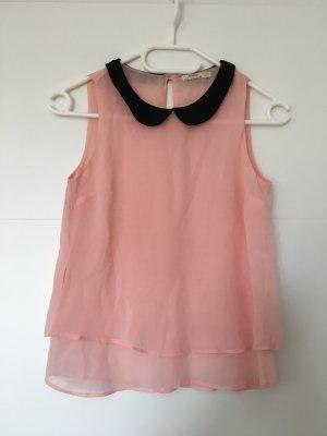 Süße rosa Bluse mit schwarzem Kragen