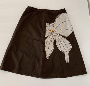 Süßer brauner Schmetterlingsrock