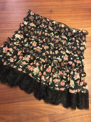 Süßer Minirock mit Blumenmuster und Spitze am Saum