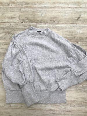 Süßer Pullover mit Puschärmeln