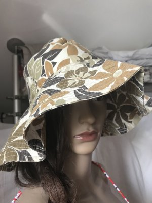 Sombrero de ala ancha marrón-blanco puro