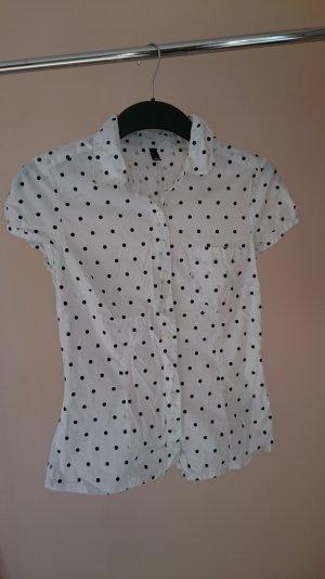 Süßes gepunktetes Blusen-Shirt
