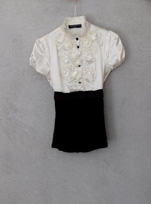Süßes RINASCIMENTO Bluse mit raschen in tailliert geschnitten