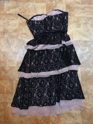 Süßes rosa schwarzes Zerokleid