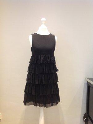 Süßes, schwarzes Volant-Kleid
