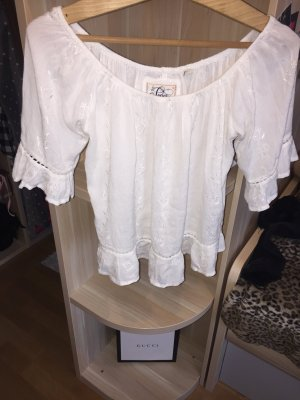 Blusa in merletto bianco
