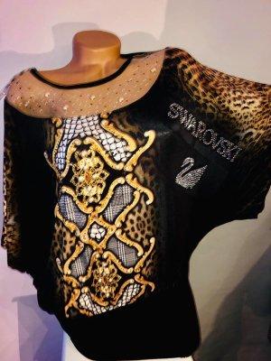 Swarovski Blusa larga negro-color bronce tejido mezclado