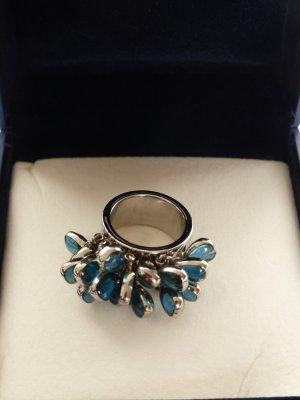 Swatch Ring mit blauen Steinen