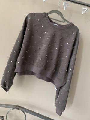 Sweater mit Nieten von Zara