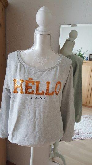 Sweater mit Pailettenschrift