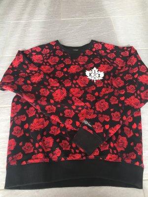 Suéter negro-rojo oscuro