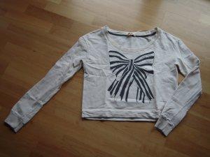 Sweatshirt cremeweiss mit aufgedruckter Schleife