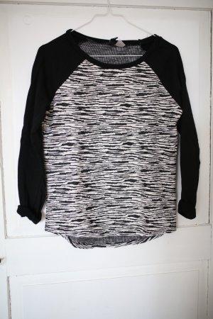 Sweatshirt in Schwarz - Weiß