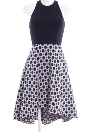 Swing Jurk met langere achterkant zwart-rosé gestippeld patroon