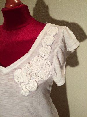 T- Shirt mit aufgenähten Blumen
