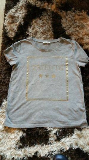 T-Shirt von EDITED MIT Gold