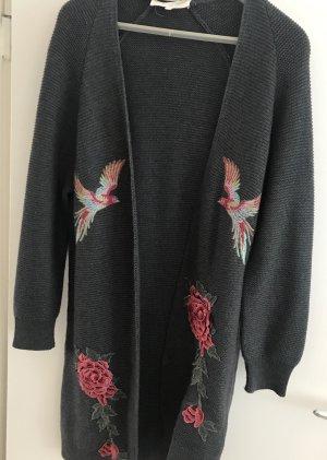 talk about Manteau en tricot multicolore