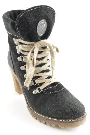 Tamaris Botas de nieve negro-crema estilo deportivo