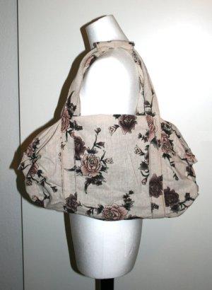 Tasche mit Blumenmuster und Glitzerstellen