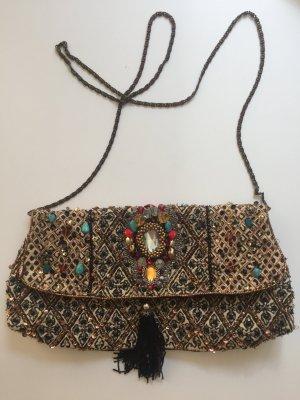 Tasche mit Steinen besetzt
