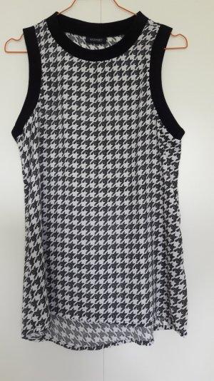 Tchibo ärmelloses Blusenshirt Hahnentritt-Muster weiß schwarz Kontrastsäume Gr. 36/38